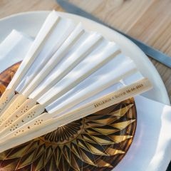 Custom designed engraved white wooden wedding fans for guests