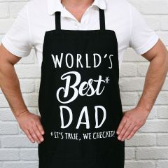 "Black Father's Day Apron with White Printed ""World's best dad, Its true we checked"" Present"